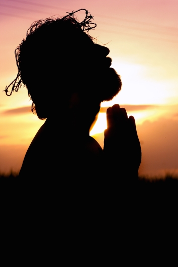 Canva - Silhouette Image of Person Praying